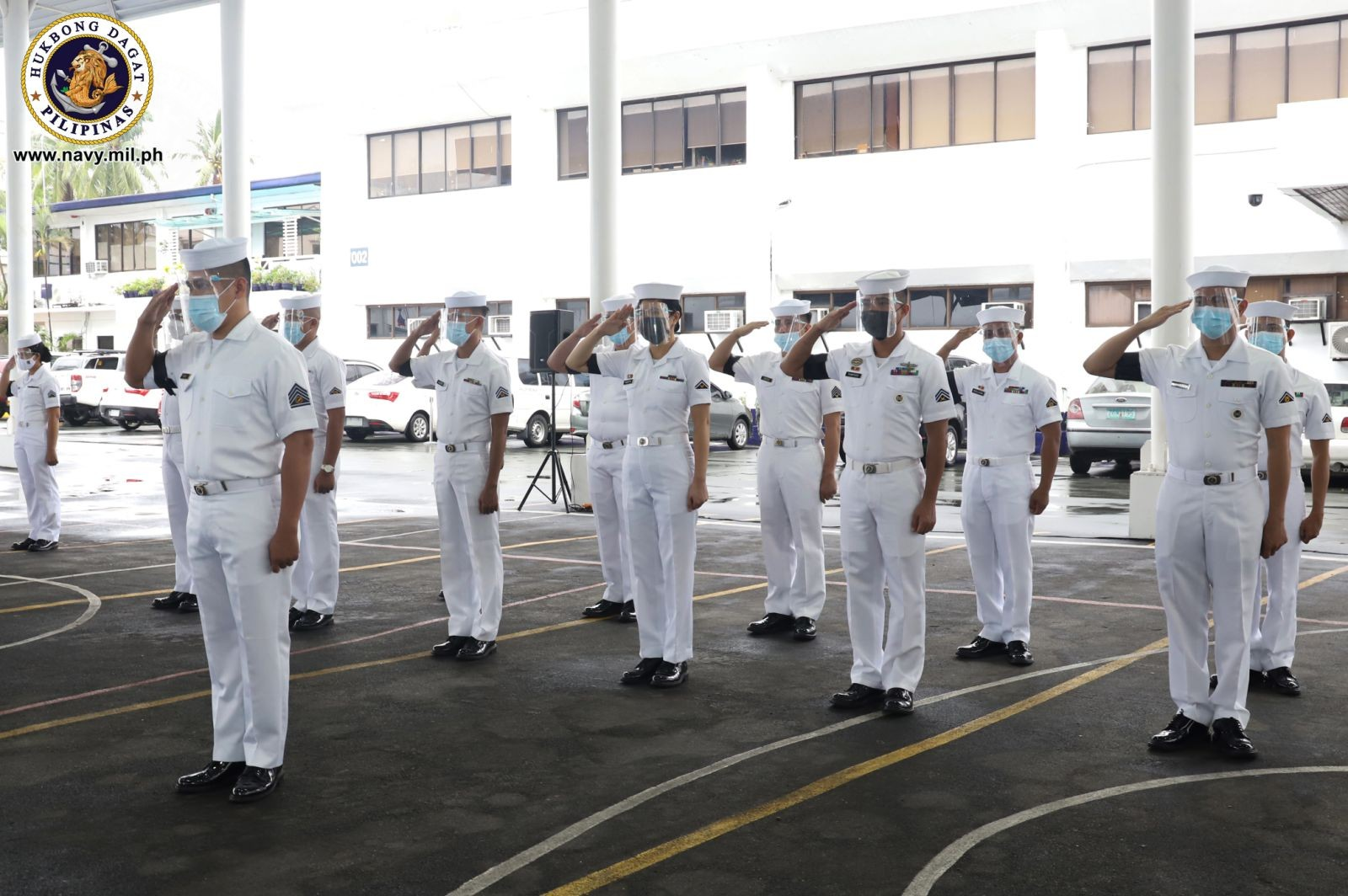 Image Title: Simultaneous Flag lowering Ceremony and Symbolic Removal of Mourning Band