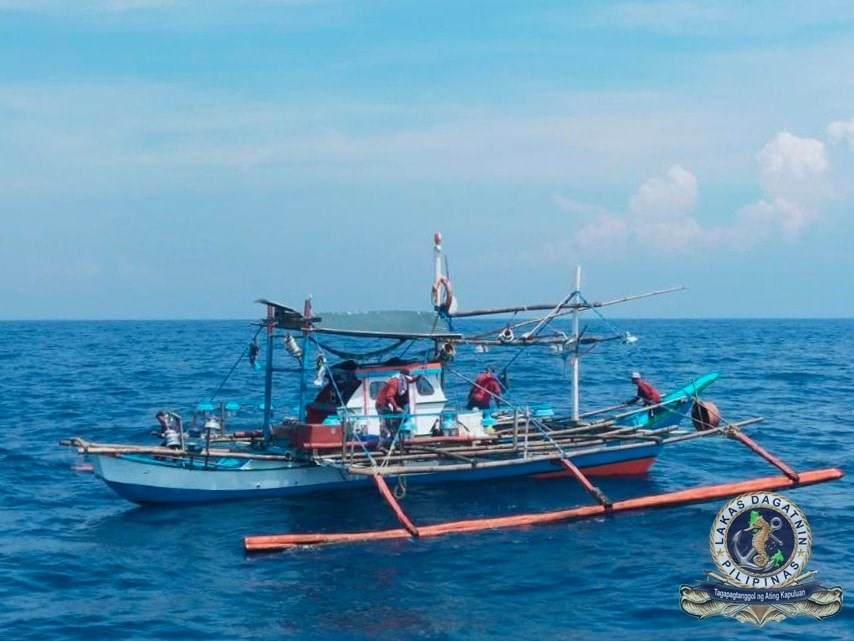 Image Title: Two Philippine Navy ships team up to rescue stranded fishermen